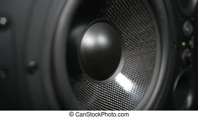Moving black sub-woofer - Closeup at moving sub-woofer....