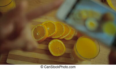 Pictures of orange and juice on mobile camera.