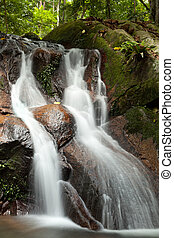 waterfall - long shutter exposure on tropical waterfall in...