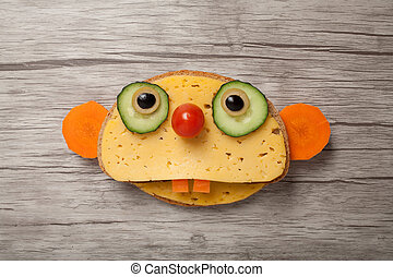 Sloth made of bread and cheese on wooden background
