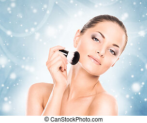 Portrait of a woman in makeup on a blue background - Spa...