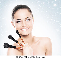 Portrait of a woman in makeup on a blue background - Face of...