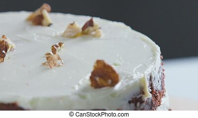 Cake Decorating walnuts. Pastry Hands decorate the cake -...