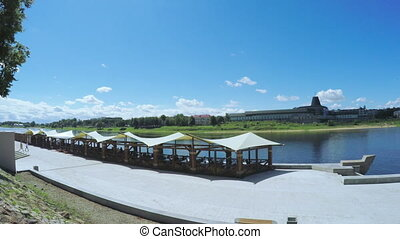 Outdoor cafe on banks of river - On bank of River Pskov...