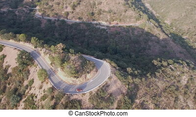 U-shape curve and 4x4 vehicle aerial view at dusk - Sunset...