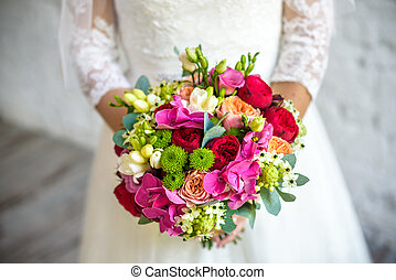 Bride holding rose pink wedding bouquet of roses and love...