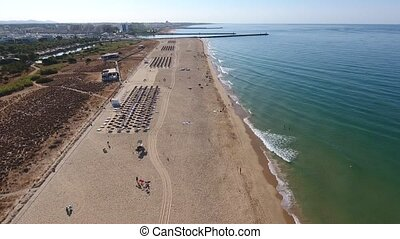 Flight filming over the beach Falesia overlooks the...