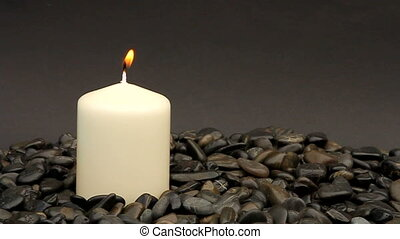 calm - candle and stones