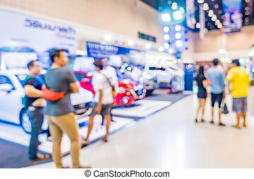 Walking in motor show blurred. - Abstract people walking in...