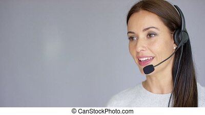Beautiful and positive female call center agent at work. She...
