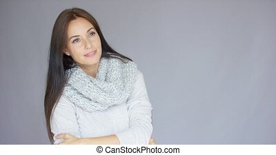 Elegant middle aged woman posing with woolen warm scarf -...