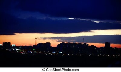 Timelapse of wonderful sunset over silhouette city skyline....