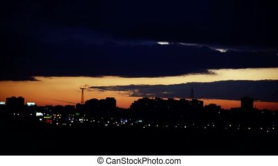 Timelapse of sunset over silhouette city skyline. 3840x2160...