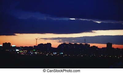 Timelapse of beautiful sunset over silhouette city skyline....