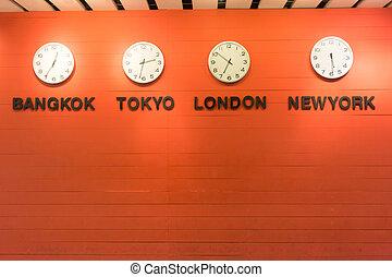 Bangkok,, Tokyo, London and Newyork Time on white wall