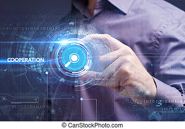 Business, Technology, Internet and network concept. Young businessman working on a virtual screen of the future and sees the inscription: cooperation