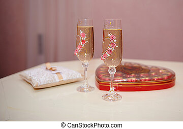 two glasses of champagne on the table for the wedding...