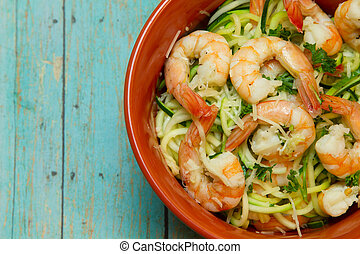 Bowl of Shrimp with Spiralized zucchini on wood board - Low...