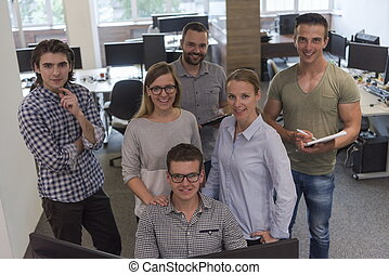 group of young startup business people standing as team at...