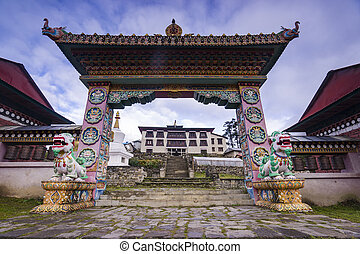 The front gate of the monastery Tengboche they guard the...