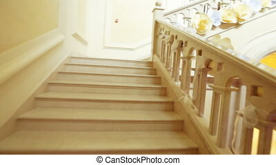 White granite staircase - Camera on steadicam up the white...