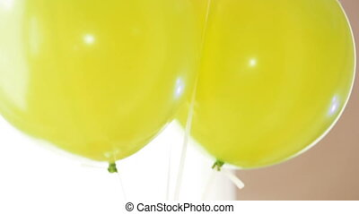 Balloons on ropess - Plenty of colorful balloons field and...