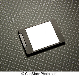Modern fast SSD Solid State Drive on gray technological...