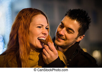 Sweet love - couple eating chocolate