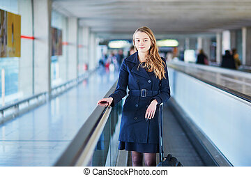 Young female traveler in international airport - Young woman...