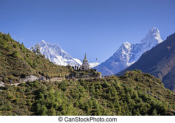 View of a Buddhist stupa with mountain Lhotse and Ama Dablam...