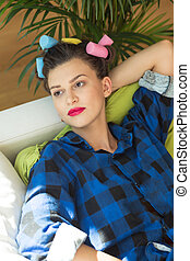 Tired housewife relaxing on a sofa - Tired housewife with a...