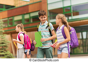 group of happy elementary school students walking - primary...
