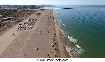 Flight filming over the beach Falesia and relaxation area....