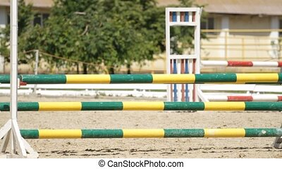 Horse jumping on a hurdle in slow motion