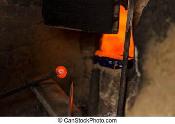 Producing amulet in furnace and with handcraft