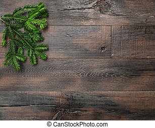Christmas tree branches on rustic wooden background....