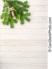Christmas tree branches on bright wooden background....