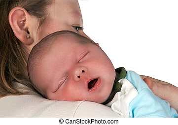 Eyes closed - Sleeping baby in his mother\'s arms, only 15...