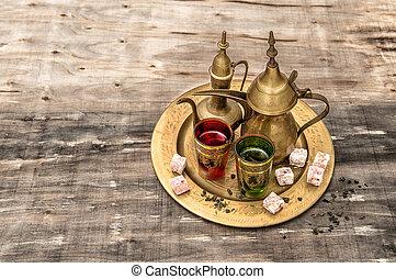 Tea table setting. Oriental hospitality. Eid Mubarak -...