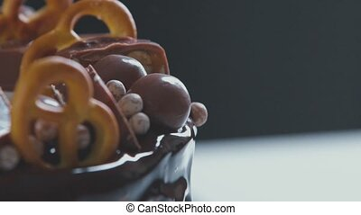 Pastry. White cream cake with chocolate icing, chocolate and...