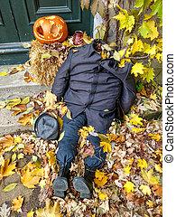 Halloween orange pumpkin and dead body