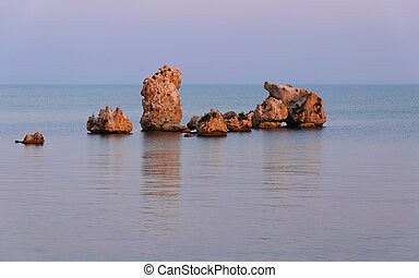 Stones in the sea. The Crimean coast in the summer