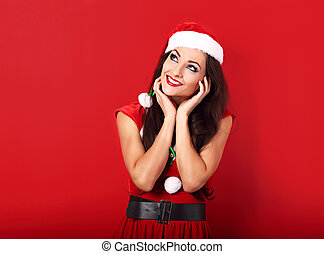 Dreaming thinking woman in santa claus christmas costume...