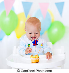 Litte boy celebrating first birthday - Adorable baby boy...