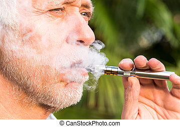 Man smoking electronic cigarette - Senior man smoking...