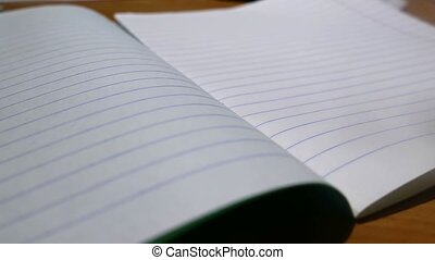 school notebook in a strip on the table homework - school...