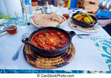 Traditional Moroccan dish kefta tajine with meat balls and...
