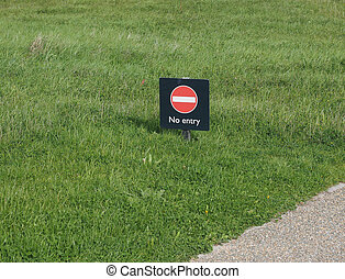 No entry sign in a meadow amidst the grass