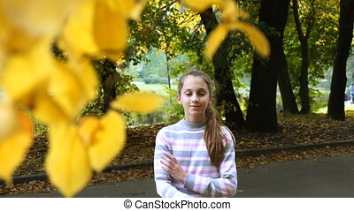 Smiling happy teen girl portrait in autumn
