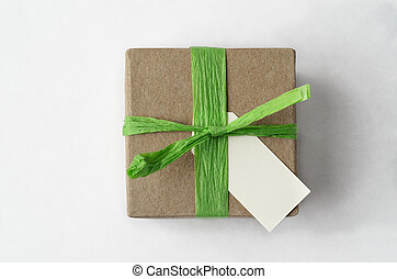Overhead of Simple Brown Gift Box with Green Raffia Ribbon...